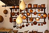 Rack with copper pots in the kitchen, Museum Grazia Deledda, Nuoro, Sardinia, Italy, Europe