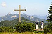 Summit cross on mount Hochries, Chiemgau, Bavaria, Germany