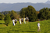 People in traditional costumes on a meadow, Reutberg abbey, Bavaria, Germany
