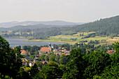 View at the town Sosnowka in front of a lake at an idyllic scenery, Sosnowka, Bohemian mountains, lower-Silesia, Poland, Europe