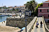 View at the bastion and the harbour in the sunlight, Alghero, Sardinia, Italy, Europe