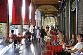 People sitting at arcades at the Via Roma, Cagliari, Sardinia, Italy, Europe