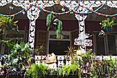 Wrought-iron balcony in Royal Street, French Quarter, New Orleans, Louisiana, USA