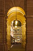 View through the arcades of the Palazzo del Governo onto the the terrace of the Cafe degli Specchi, Trieste, Friuli-Venezia Giulia, Upper Italy, Italy