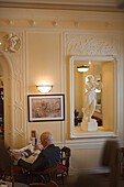 Pensioner, Man reading the newspaper in Cafe Tommaseo, Trieste, Friuli-Venezia Giulia, Upper Italy, Italy