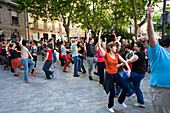 People dancing on a square in the old town of Palma, Mallorca, Spain, Europe