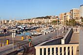 Jogger on seaside promenade at marina, Palma, Mallorca, Balearic Islands, Mediterranean Sea, Spain, Europe