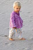 A little girl walking over the sandy beach, Punta Conejo, Baja California Sur, Mexico, America