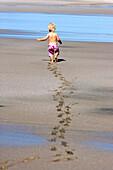 Little girl leaving footprints in the wet sand, Punta Conejo, Baja California Sur, Mexico, America