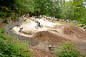 Teenagers jumping with dirt bikes, Starnberg, Bavaria, Germany