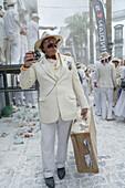 Man in fancy dress with suitcase, Talcum powder battle, local festival, revival of the homecoming for emigrants, Fiesta de los Indianos, Santa Cruz de La Palma, La Palma, Canary Islands, Spain, Europe