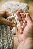 Showing the ´knit´ Stitch  Hands holding yarn in ´American Style´ knitting position