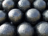 a graphic close up shot of cannonballs stacked