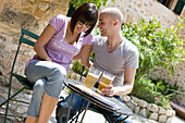 Adult, Adults, Alcohol, Alcoholic beverage, Alcoholic beverages, Alcoholic drink, Alcoholic drinks, Amusement, Beer, Cafe terrace, Cafe terraces, Caucasian, Caucasians, Chair, Chairs, Chat, Chatting, Color, Colour, Contemporary, couple, couples, Daytime,
