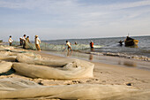 Fishermen with fishing net on the beach of Mui Ne, Binh Thuan Province, Vietnam, Asia