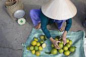 Vietnamese woman at the market at Cai Rang, Mekong Delta, Can Tho Province, Vietnam, Asia