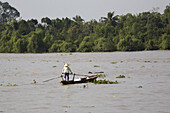 Vietnamese woman on a boat on the Mekong River, Mekong Delta, Can Tho Province, Vietnam, Asia