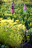 Two girls (6-9 years) in vegetable patch, Lower Saxony, Germany