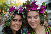 Two young women in colourful costumes at the Madeira Wine Festival, Funchal, Madeira, Portugal