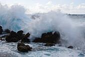 Breaker wave crashing on lava rocks, Porto Moniz, Madeira, Portugal