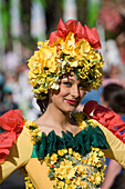 Young woman in a floral costume at the Madeira Flower Festival, Funchal, Madeira, Portugal