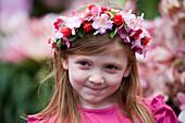 Girl with flower headdress at the Madeira Flower Festival, Funchal, Madeira, Portugal