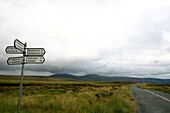 Signpost at The Old Military Road under clouded sky, Wicklow Mountain National Park, County Wicklow, Ireland, Europe