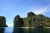 Sandy beach on an uninhabited limestone island in the Bacuit Archipelago, El Nido, Palawan, Philippines