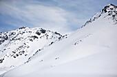 Snowboarder riding downhill in powder snow, Kappl, Tyrol, Austria