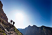 Two hikers ascenting mount Zugspitze, Wetterstein Range, Bavaria, Germany