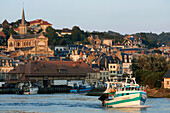 Fishing Boat Leaving The Port In Front Of The Notre-Dame Des Victoires Church, Trouville-Sur-Mer, Calvados (14), Normandy, France