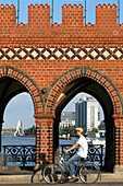 Oberbaumbrucke Bridge Over The Spree And Molecule Man In The Background, Kreutzberg Neighbourhood, Berlin, Germany
