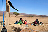 Nomad Women Washing Their Laundry Near The Well, Association For The Development Of Nomad Life In The Zagora Region, Berber People, Morocco, Maghrib, North Africa