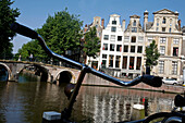 Dutch Bicycle And Traditional Houses Along The Canals, Amsterdam, Netherlands, Holland