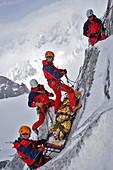 Firefighter In Action, Winter Exercise In The Alps, Conditioning Of A Victim On A Stretcher And Preparation Of The Relay For His Evacuation, Emergency Service Mountain Squad (Gmsp74), Petite Aiguille Verte, Mont-Blanc, Haute-Savoie (74), France