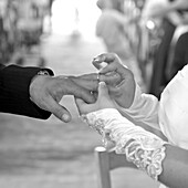 The Bride Putting The Wedding Ring On Her Future Husband'S Finger At The Church On The Wedding Day, France