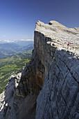Woman standing at cliff, Gadertal, Zehner, Naturpark Fanes-Sennes-Prags, Dolomites, Trentino-Alto Adige/South Tyrol, Italy
