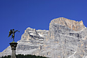 Statue of an angel on spire in front of Monte Pelmo, Dolomites, Veneto, Italy