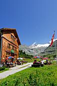 Guests beside Alpenrose inn near alpine hut Berliner Huette, Zillertal, Zillertal Alps, Tyrol, Austria