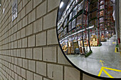convex traffic mirror in large Rossmann warehouse, Burgwedel, near Hanover, Lower Saxony, Germany