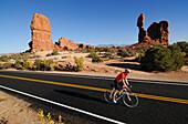 Racing cyclist, Arches National Park, Moab, Utah, USA