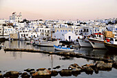 Boats at harbour in the afterglow, Naoussa, island of Paros, the Cyclades, Greece, Europe