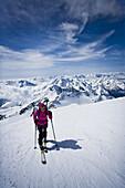 Back country skier ascending mount Weisskugel, Oetztal Alps, Tyrol, Austria