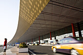Woman and taxi in front of the International Airport Beijing, largest building in the world, Peking, China, Asia