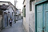 Woman at an alley, Gulangyu island, Xiamen, Fujian province, China, Asia