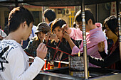 People with incense sticks at Nanputuo temple, Xiamen, Fujian province, China, Asia
