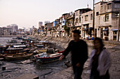 Old harbour with fishing boats at low tide, Siming district, Xiamen, Fujian province, China, Asia