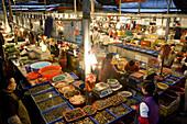 Vendors and customers at the fish market, Xiamen, Fujian province, China, Asia