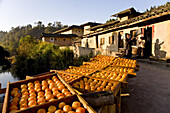 The village Hongkeng of the Hakka at a river in the morning, fruit drying in the sun, Hongkeng, Longyan, Fujian, China, Asia