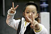 Portrait of a little Chinese boy, Xiamen, Fujian, China, Asia